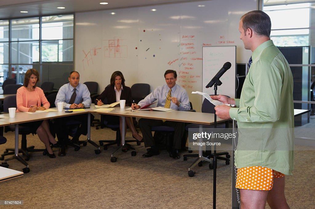Businessman giving presentation in his underwear : Stock Photo