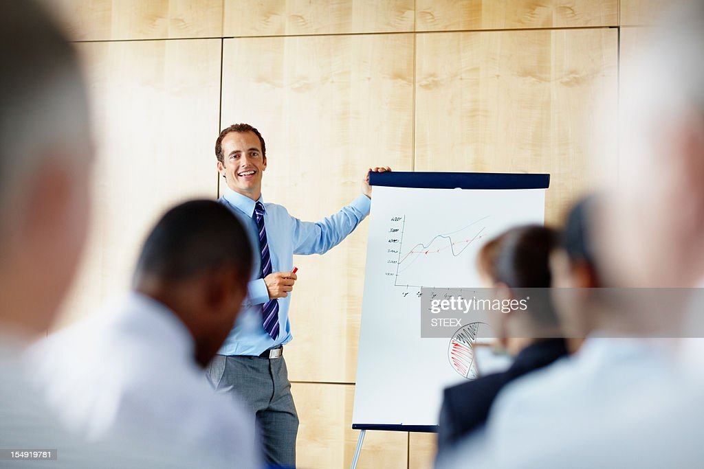 Businessman giving presentation : Stock Photo