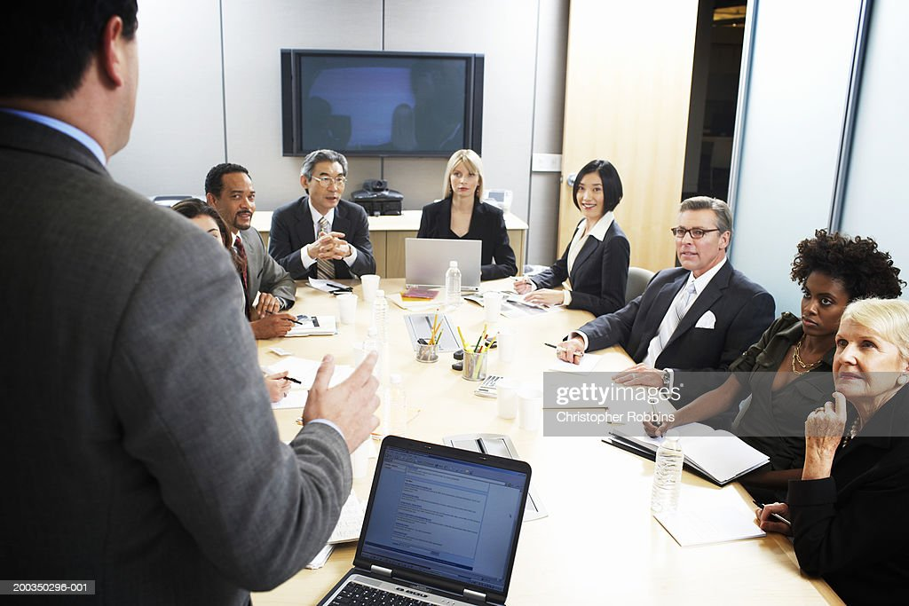 Businessman giving presentation, rear view : Stock Photo