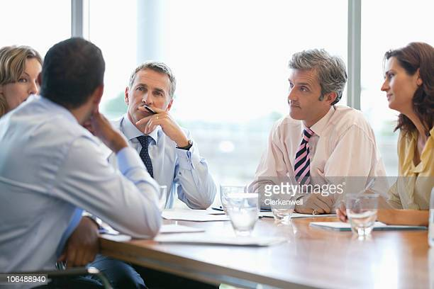 Businessman giving presentation to co workers at conference room
