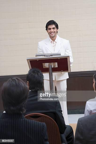 Businessman giving speech in a seminar