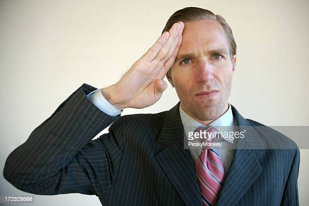 Businessman Giving the Camera a Military Salute