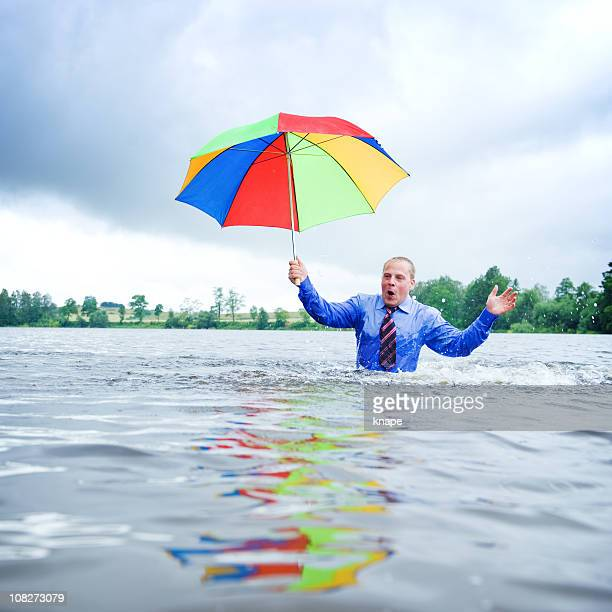 Businessman going into deep water