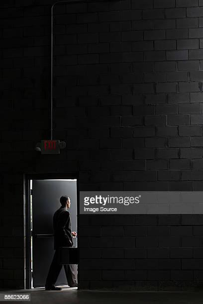 Businessman going through door