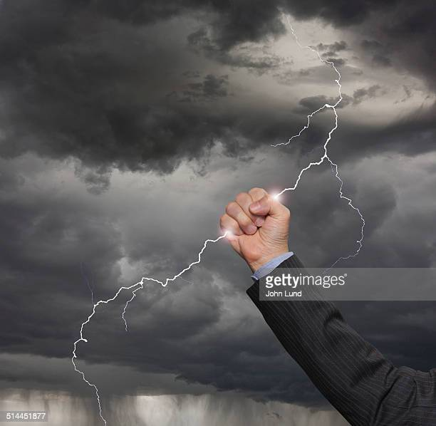 Businessman Grabs A Lightning Bolt