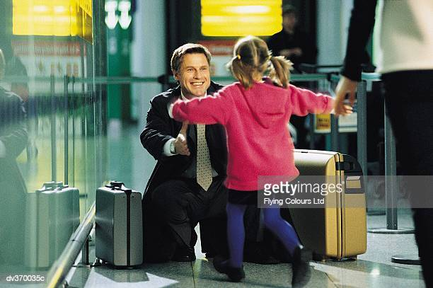 Businessman greeting child at airport