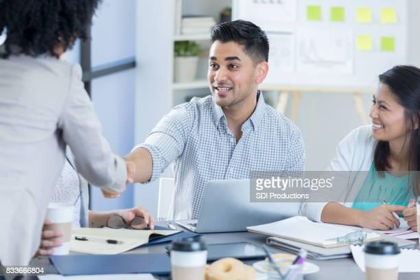 Businessman greets clients