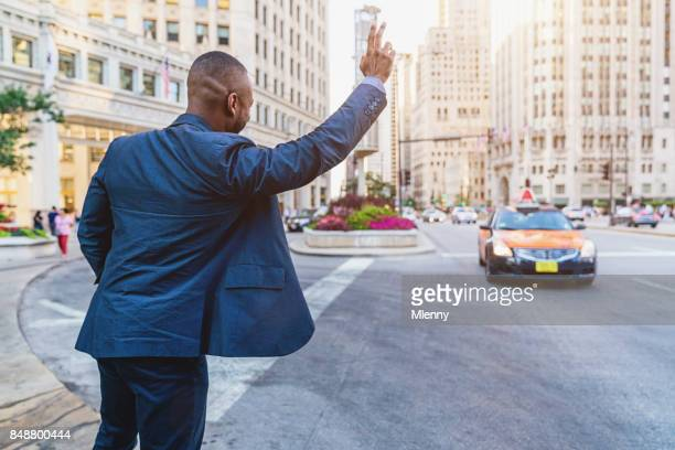 Businessman Hailing a Cab in Downtown Chicago
