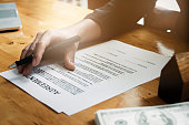 Businessman hand and contract agreement paper with customer to sign contract. Real Estate and Agreement concept.