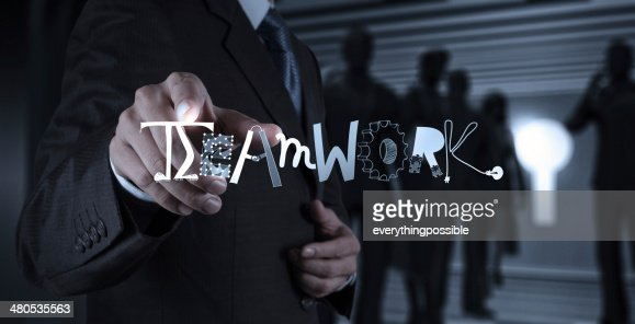 businessman hand drawing design graphic word TEAMWORK as concept : Stock Photo