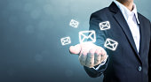 Businessman hand holding e-mail icon, Contact us by newsletter email and protect your personal information from spam mail concept