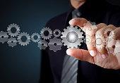 Businessman hand show glass gear to success as concept, Teamwork concept