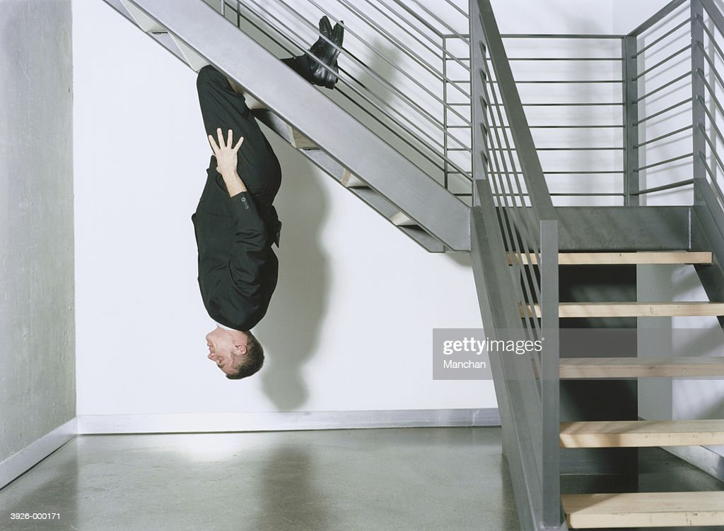 Businessman Hanging on Stairs : Stock Photo