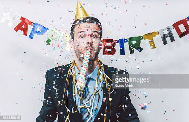 Businessman having a birthday party.