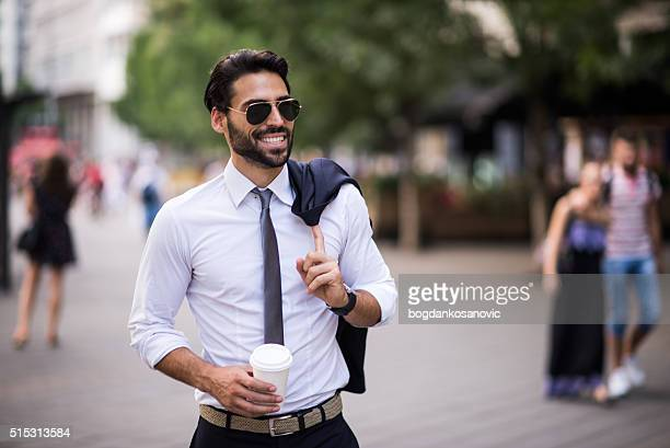 Businessman having a walk in the city