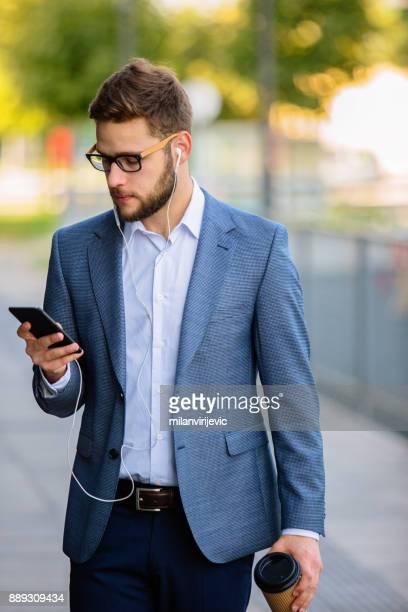Businessman having phone call outdoors
