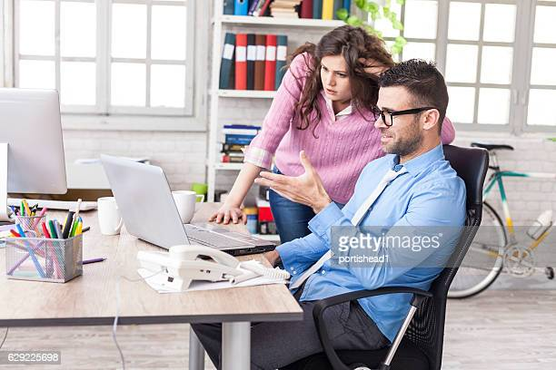 Businessman having problem on laptop at work