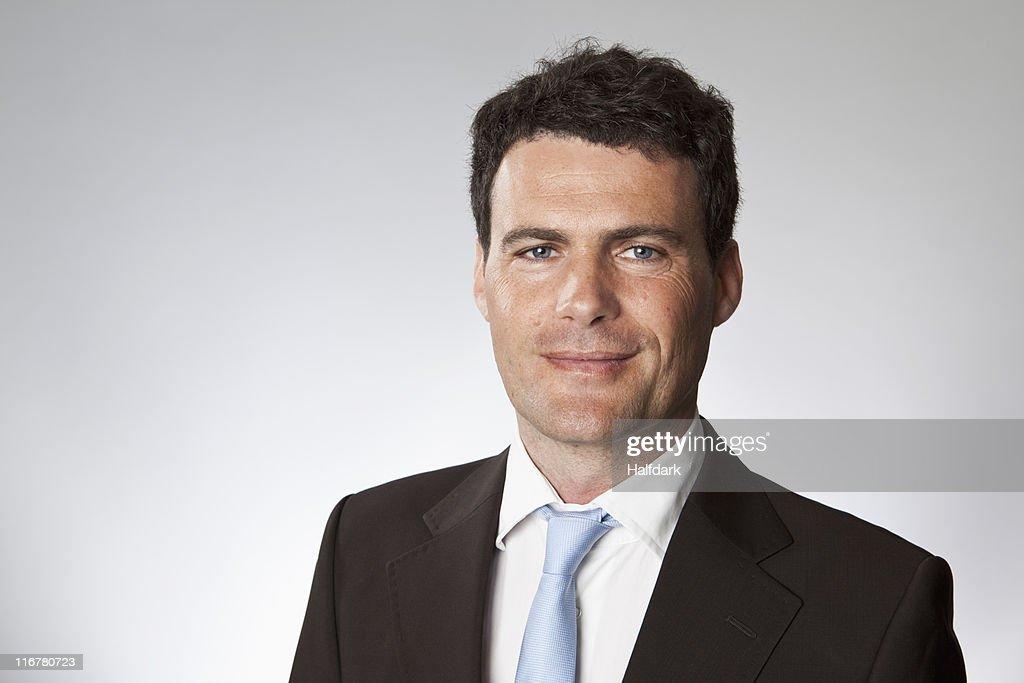 A businessman, head and shoulders, portrait