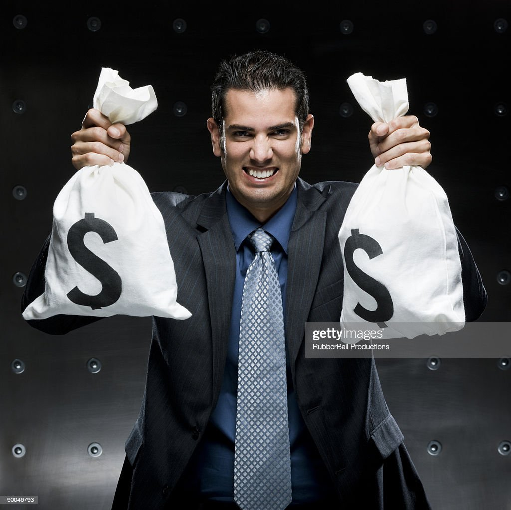 businessman holding a bag of money : Stock Photo