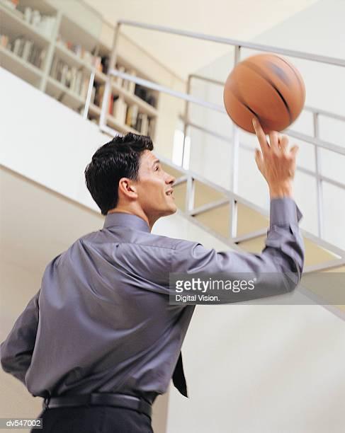 Businessman Holding a Basketball