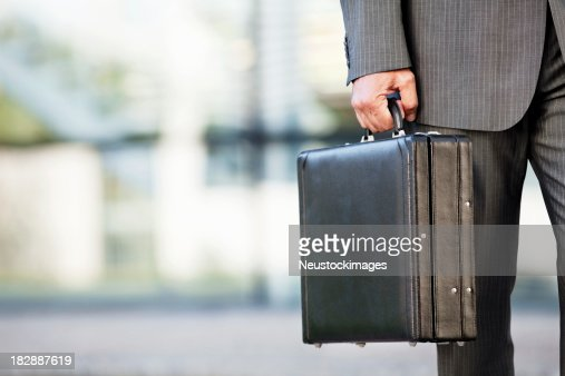 Businessman Holding a Briefcase Outdoors
