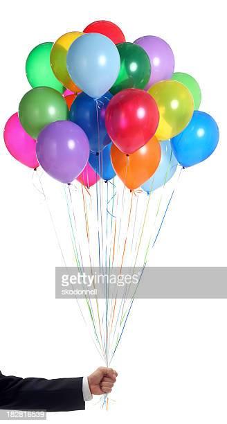 Geschäftsmann hält einen Haufen bunte Ballons auf Weiß