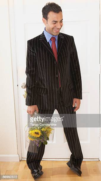 Businessman holding a bunch of flowers