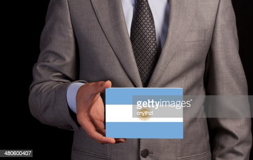 Businessman Holding a Card with ARGENTINA Flag : Stock Photo
