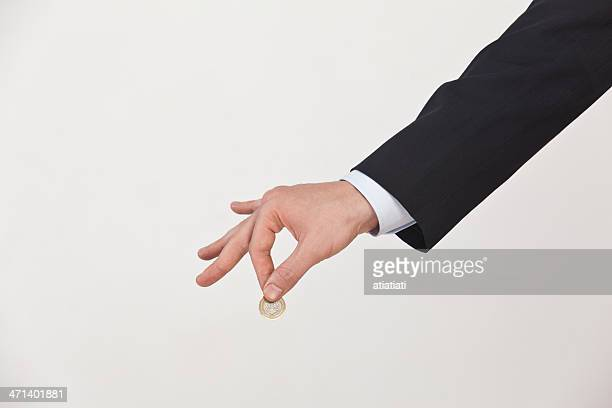businessman holding a coin