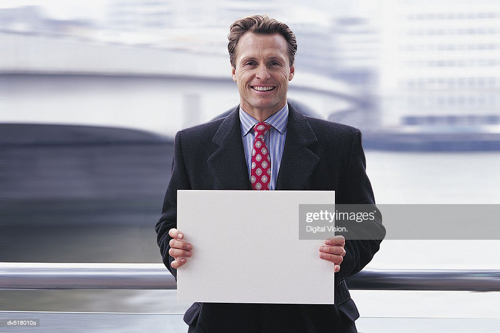 Businessman holding a piece of paper