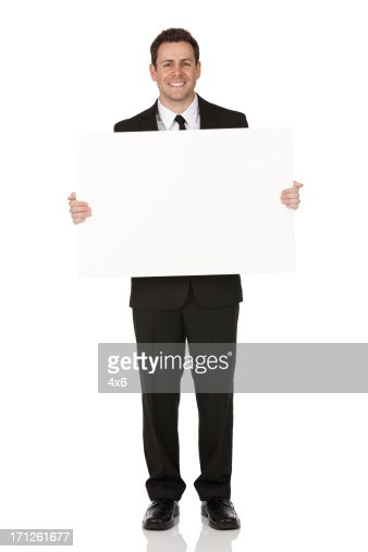 Businessman holding a placard
