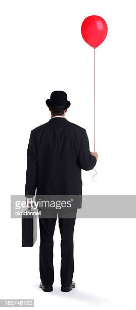 Businessman Holding a Red Balloon on White
