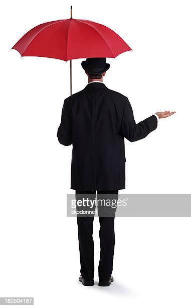 Empresario sosteniendo una sombrilla, rojo
