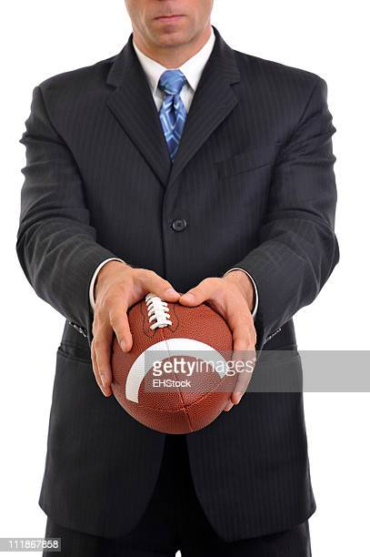 Businessman Holding American Football Isolated on White Background