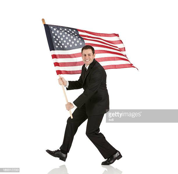Businessman holding an American flag
