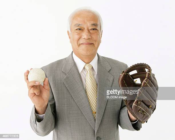 Businessman Holding Baseball Accessories
