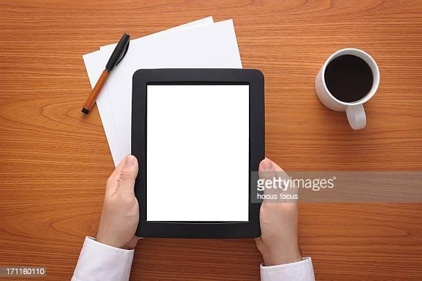 Businessman holding blank tablet pc