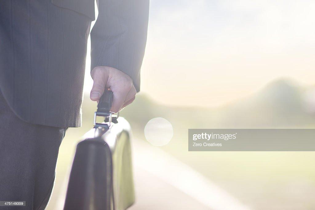 Businessman holding brief case