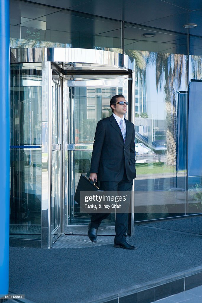 Businessman holding briefcase and walking