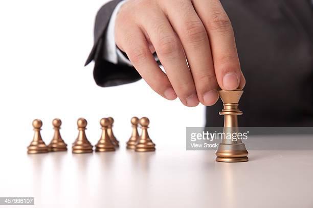 Businessman holding chess item