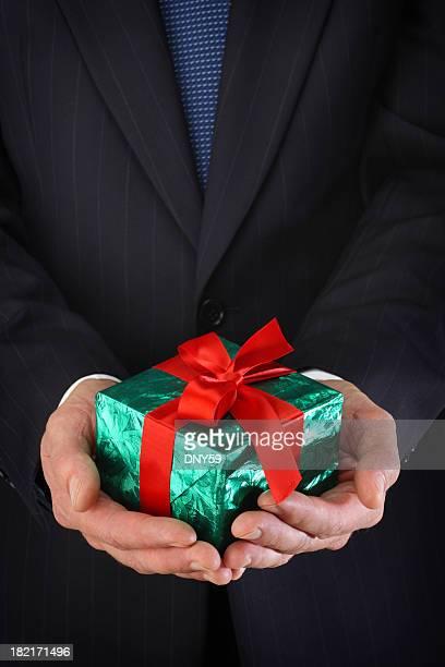 Businessman Holding Christmas Gift