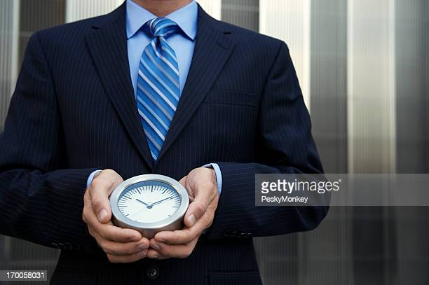 Businessman Holding Clock Modern Background