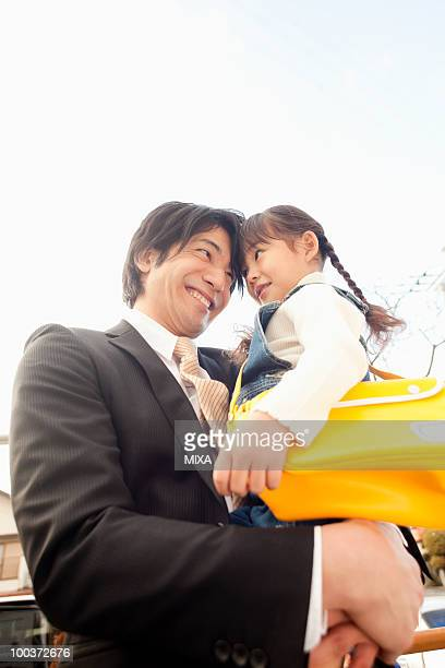 Businessman Holding Daughter
