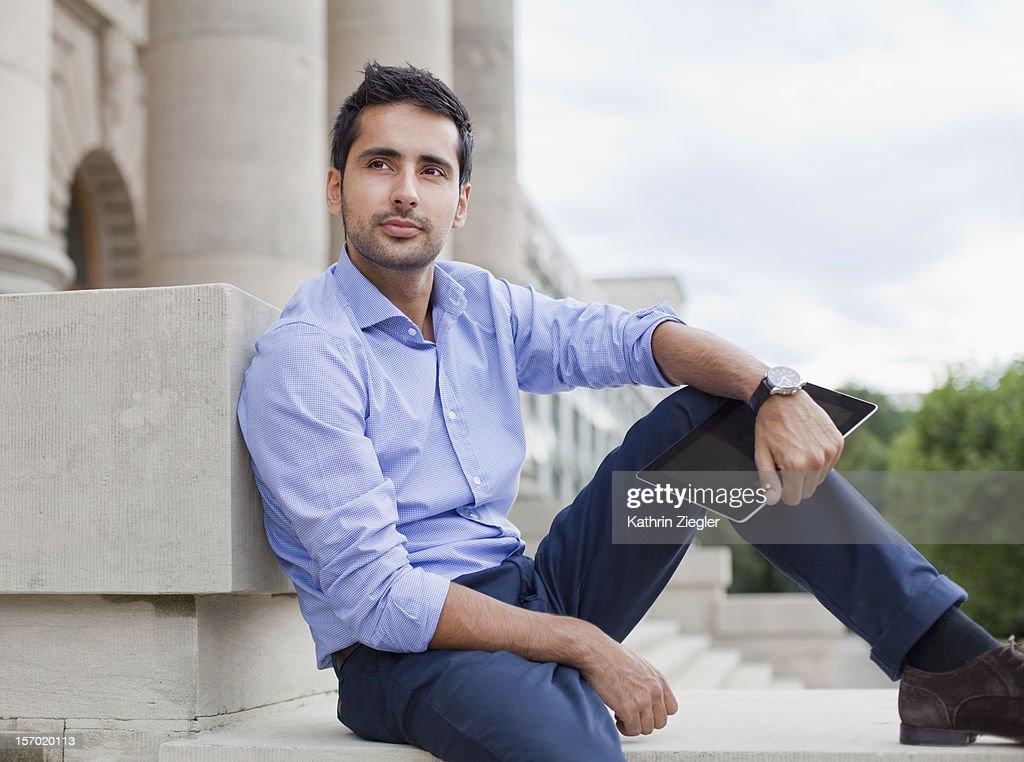 businessman holding digital tablet : Stock Photo