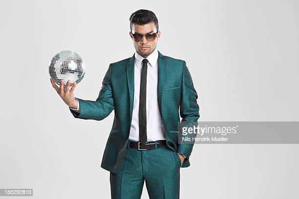 Businessman holding disco ball