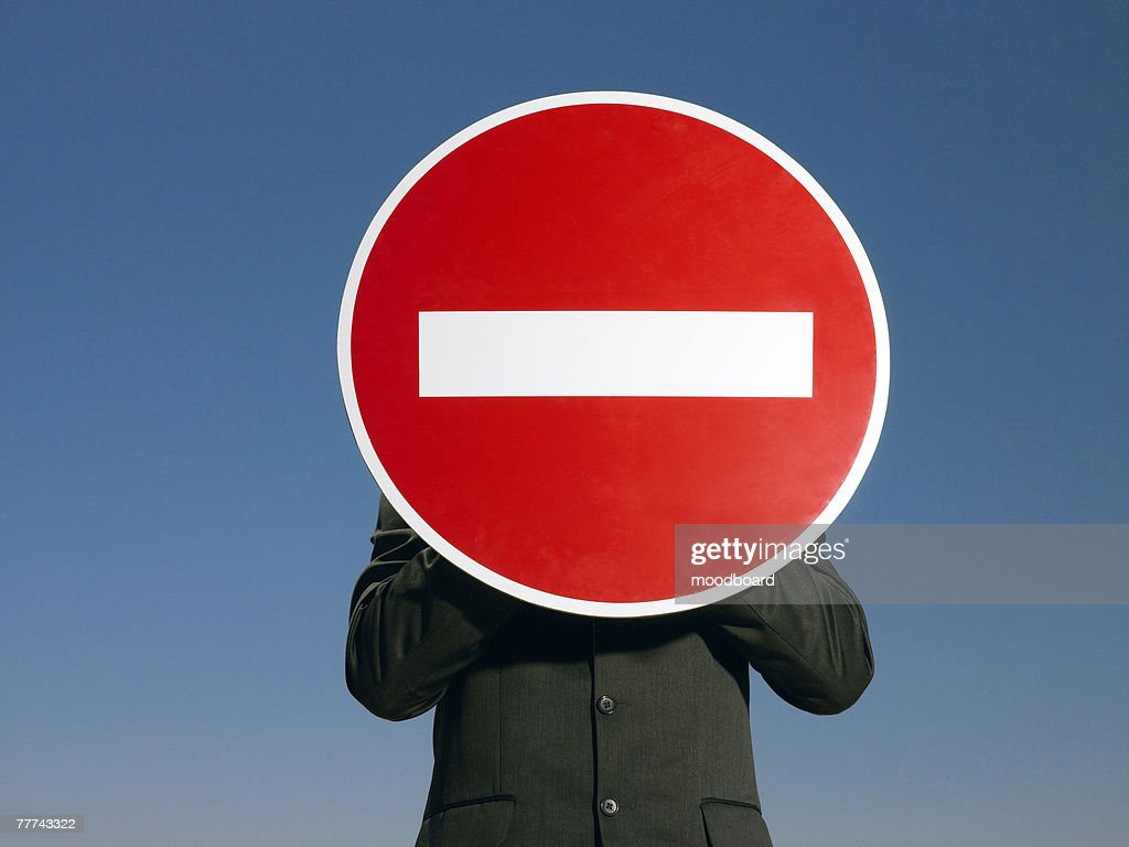 Businessman Holding Do Not Enter Sign