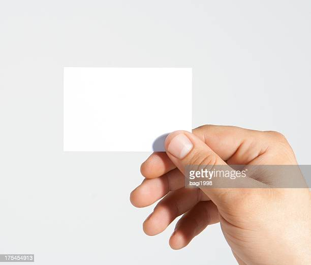 Businessman holding empty card