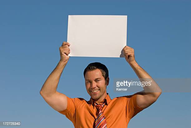 businessman holding empty sign