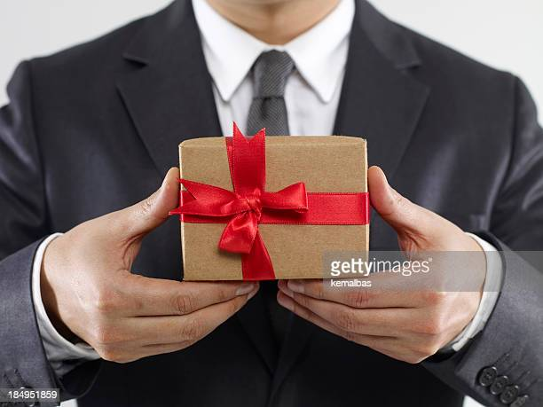 Businessman Holding Gift Box