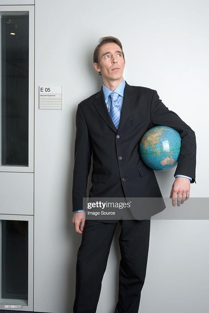 Businessman holding globe : Stock Photo